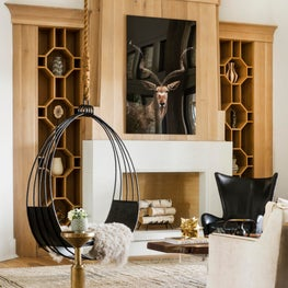 Horse Meadow country house featuring custom steel swing chair and intricate white oak bookcases.