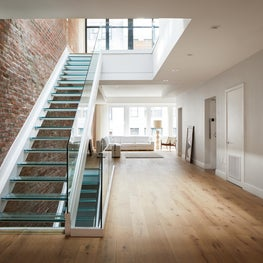 Union Square Penthouse, Glass Staircase at Entrance Foyer