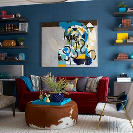 Back Bay Boston family room with teal grasscloth and burgundy sleeper sofa