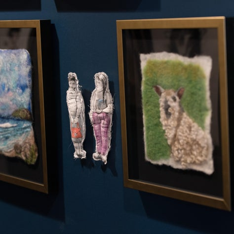 A pair of hand-made art dolls sewn and illustrated by Marina Povalishina.