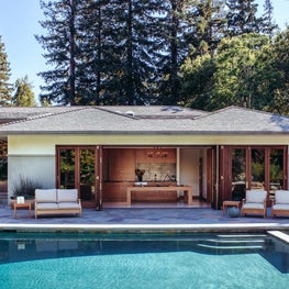 California ranch house with dining room opening onto pool