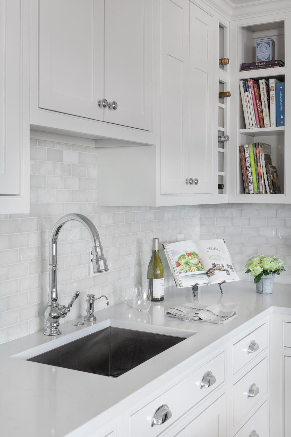 White and bright kitchen with a lobster pot size faucet