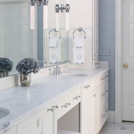 Serene Master Bath with Marble and Pale Blue Wallpaper