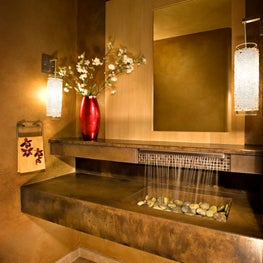 Contemporary zen powder room with custom concrete vanity and waterfall faucet