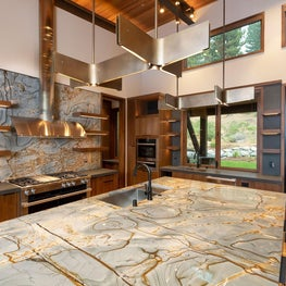 Rays of Light - walnut cabinets and open shelving, blue quartzite countertop, walnut planks and spanning bronze pendants