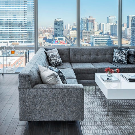 Chicago Condo, Blue Sectional, Grey Hardwood, White Lacquer Table, Skyline