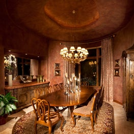 Elegant formal dining room in reds, golds with faux walls & ceiling, custom rug