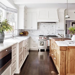 White cabinets with wood island in Hillsborough residence.