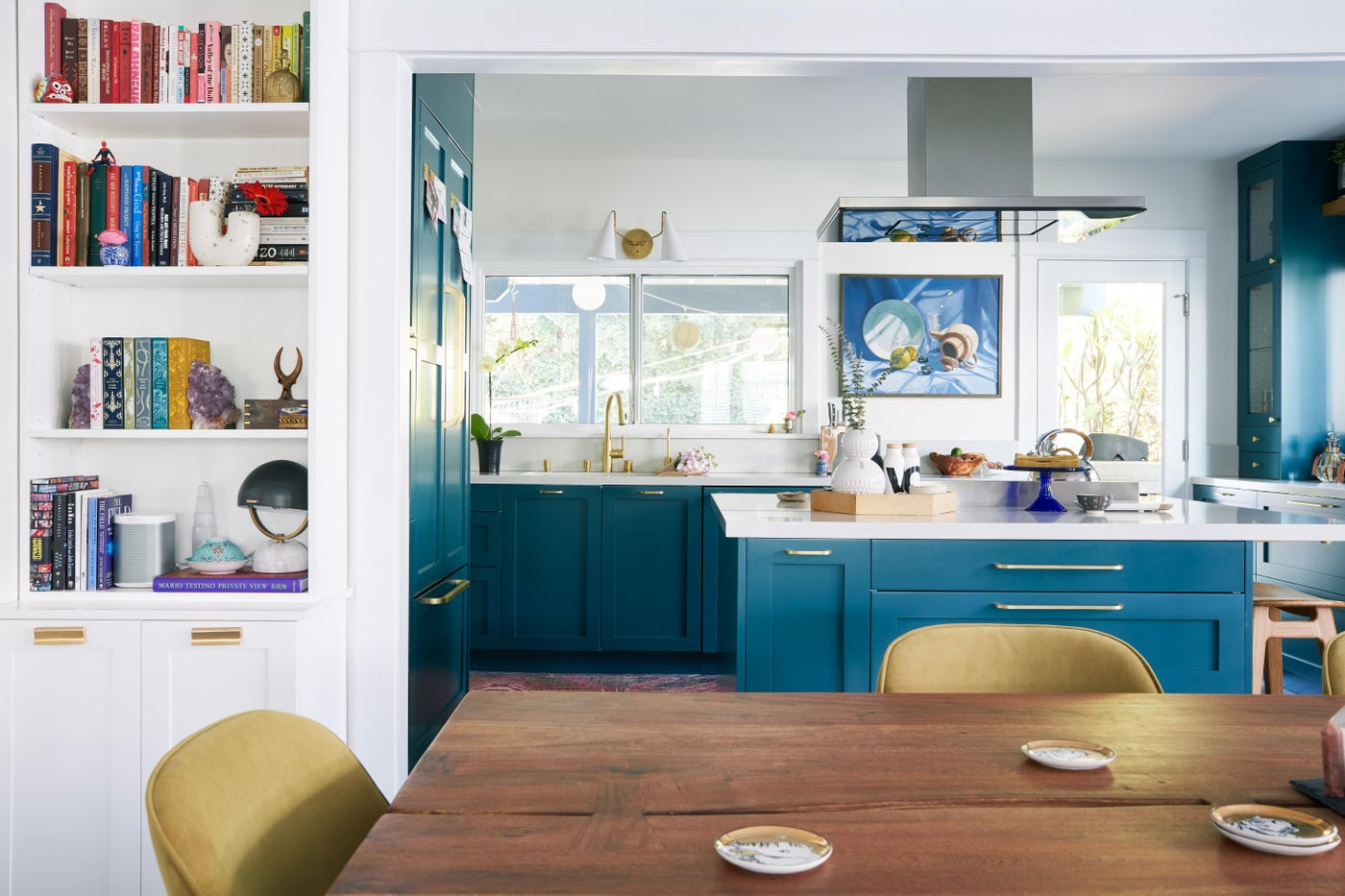 Bungalow Charm/ A centenarian bungalow begs for a 21st century aesthetic while honoring its history. With teal shaker cabinetry, handmade tiles and functional storage, its new open floor plan cheerily embraces the West Coast way of life.