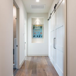 Hallway with sliding barn doors, inset artwork