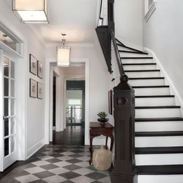Stair Hall with Checkered Stone Floor and Painted Balustrade