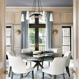 Bleached oak high waisted wainscot in a transitional Palm Beach Dining Room