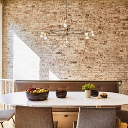 Hudson Street Brownstone I Dining Room | Dining Nook | Exposed Brick