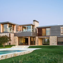Integrated pool with sculpted lawns and meadow.