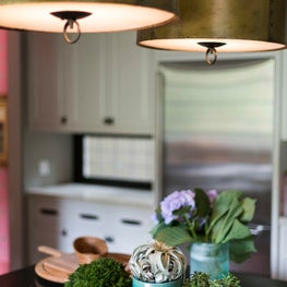Kitchen island with Brass pendants