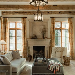 Muted Perfection / Hand hewn beams from Europe give structure to this cozy family room filled with light and simple, elegant Italian furnishings.