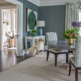 Wallpapered Dining Room with Painted Ceiling, Green Accents and Sheep Stools