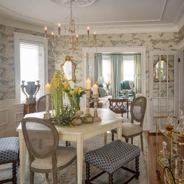 Dining room geometric table eclectic seating wallpaper medallion stools bar cart