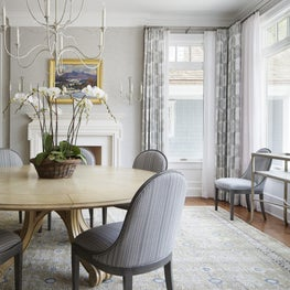 Bright and airy dining room with rich details and materials