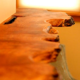 NW hills, Portland, OR:  Live-edge maple fireplace mantel in master bedroom.