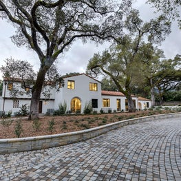 Spanish Colonial Equestrian Estate, front exterior, paver drive and oaks