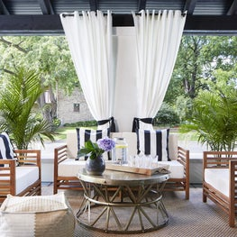 A stunning veranda area connects the indoor and outdoor living spaces