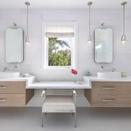 Elegant two sink vanity combines wood and white elements in Key Largo, Florida.