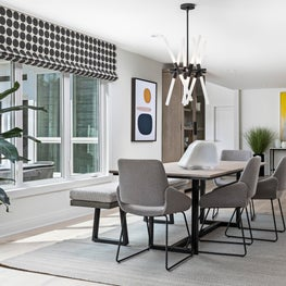 The layout allows  to move around from dining area to kitchen to living space.
