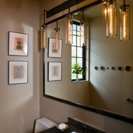 Powder Room with custom lighting and mirror