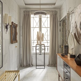 Left Bank Paris hallway in gray, gold, and white with trompe l'oeil marble walls
