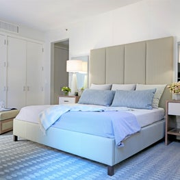 West Village Triplex Master Bedroom with light colors, double mirrors, chair