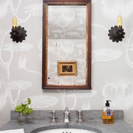 Country House powder bath with antique mirror and sconces