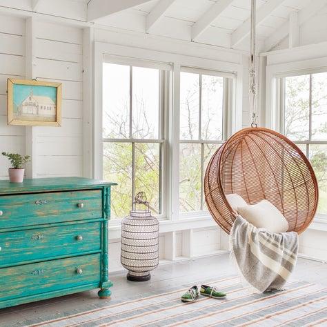 Hanging rattan chair; indoor-outdoor area rug; distressed, turquoise dresser
