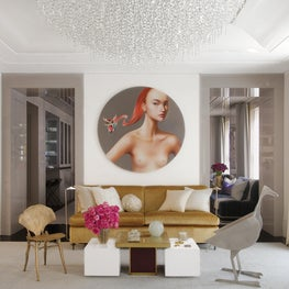 Living room with Ling Jian nude over eclectic seating, gold upholstery, dove gray metallic carpeting, and a custom crystal chandelier