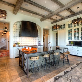 White Oceanfront Kitchen with Reclaimed Beams, Steel Island & Hood