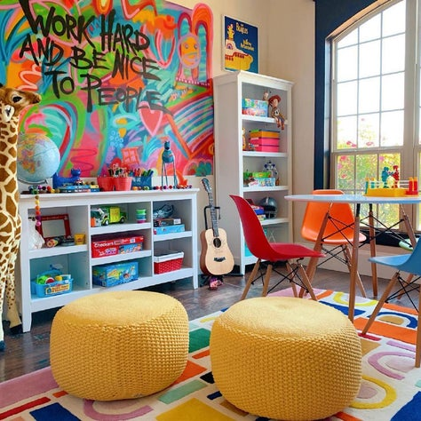 Playroom with wall mural and colorful rug