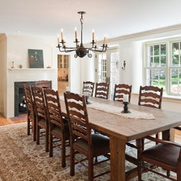 Farmhouse Dining Room with fireplace and iron light fixture in Malvern, PA
