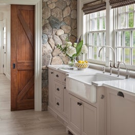 Farmhouse Kitchen with New England Fieldstone Accent Wall and Sliding Barn Door