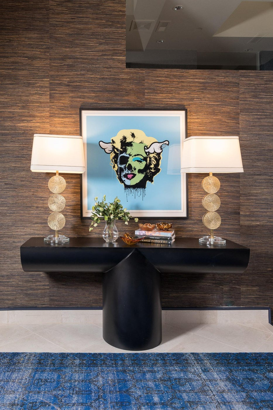 Penthouse foyer featuring vintage lamps and modern art