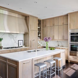 Kitchen, Light Brown Wood Cabinets, Quartz Island, Six-burner Cooktop, Miele Appliances, Emeco Chairs - Glencoe Contemporary Project