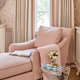 Girl's room with blush chaise lounge chair and soft blush wall covering