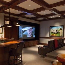Media room with wood beams & theater seating