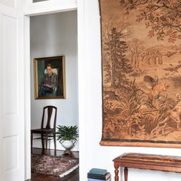 Victorian master bedroom to hallway with antique European tapestry