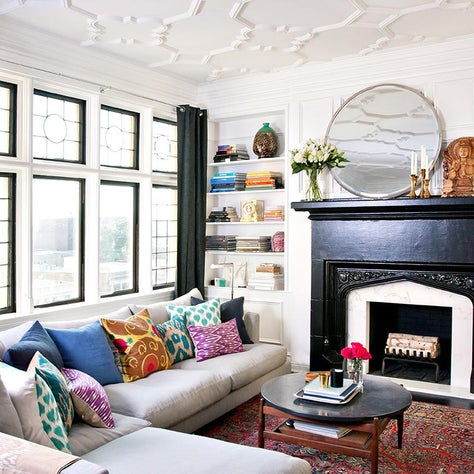 Black and White Pied a Terre with custom ceiling, fireplace, and colorful rug