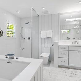 Crisp White Oceanside Cottage Master Bath w/shiplap wall detailing
