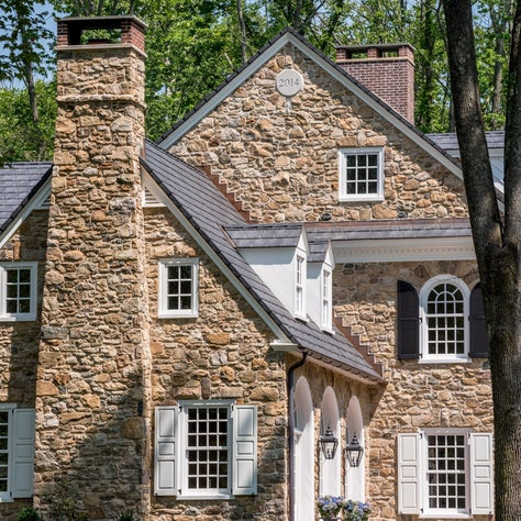 Colonial Revival Stone Farmhouse with arch top window details in Horsham, PA