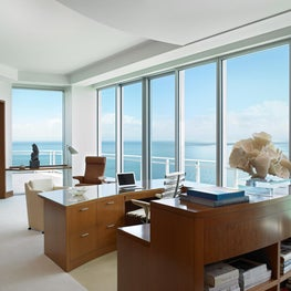 An oceanfront home office in a sophisticated and highly styled environment.