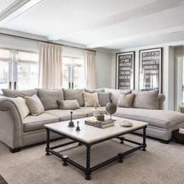 Family room in Hillsborough residence with transitional accent pieces.