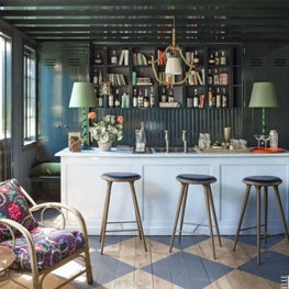 Bar with deep walls and ceiling, eclectic seating