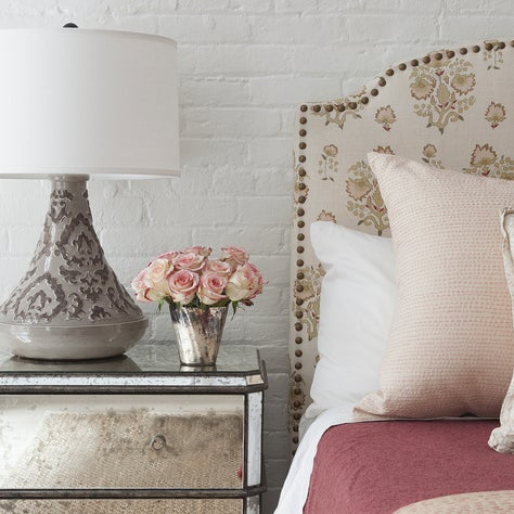 Upholstered headboard in master bedroom.